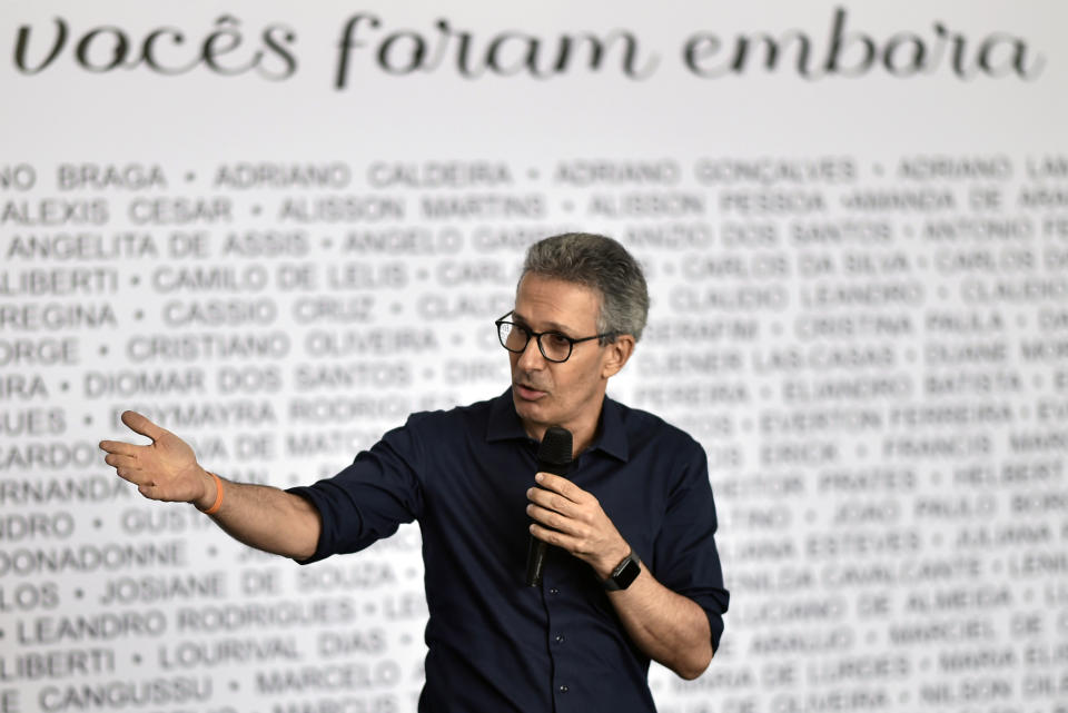 Minas Gerais state Governor Romeu Zema speaks in front of a wall with the names of the victims of the January 25, 2019 dam collapse, during a tribute in Corrego do Feijao, district of the Brumadinho, state of Minas Gerais, Brazil, on January 25, 2020, to mark one year since the disaster which killed 270 people. - Brazil marks the first anniversary of the Brumadinho dam collapse, one of the country's worst industrial accidents. Millions of tons of toxic mining waste engulfed houses, farms and waterways, devastating the mineral-rich region in the southeastern state of Minas Gerais. It was the second such disaster involving Brazilian mining giant Vale, one of the biggest mining companies in the world, in three years. (Photo by DOUGLAS MAGNO / AFP) (Photo by DOUGLAS MAGNO/AFP via Getty Images)