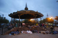 Migrants sleep under a gazebo at a park in the Mexican border city of Reynosa, Saturday, March 27, 2021. Dozens of migrants who earlier tried to cross into the U.S. in order to seek asylum have turned this park into an encampment for those expelled from the U.S. under pandemic-related presidential authority. (AP Photo/Dario Lopez-Mills)