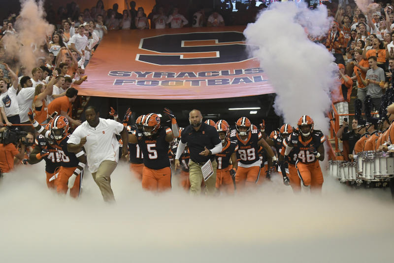 Syracuse team enters the Carrier Dome during the NCAA college football game Saturday, Sept. 14, 2019, in Syracuse, N.Y. (AP Photo/Steve Jacobs)