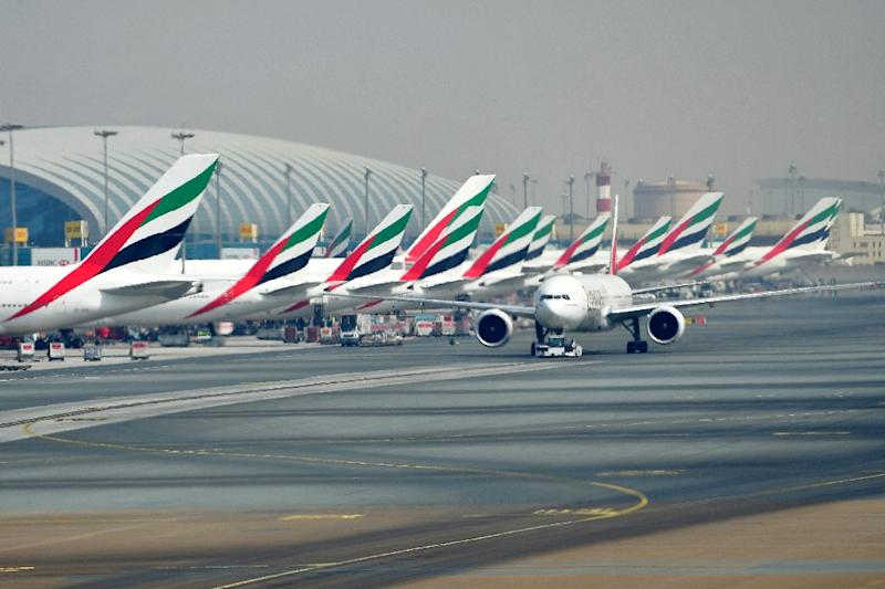 A picture taken on September 14, 2017 shows Emirates planes parked on the tarmac at Dubai's International Airport (AFP Photo/GIUSEPPE CACACE)