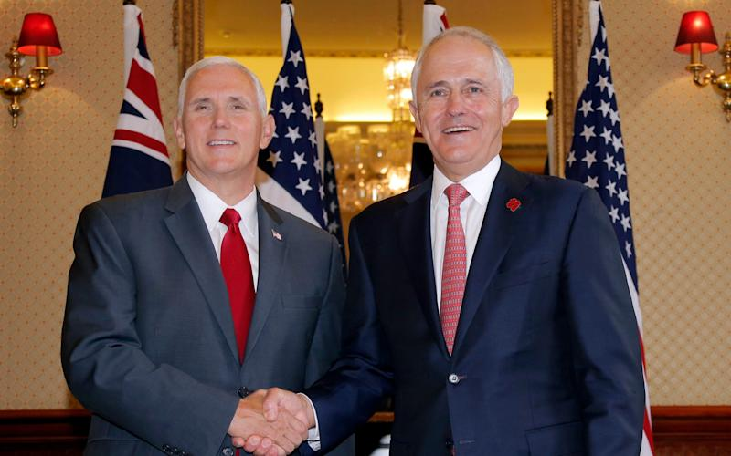 US vice president Mike Pence shakes hands with Australia's Prime Minister Malcolm Turnbull  - Credit: Jason Reed/Reuters