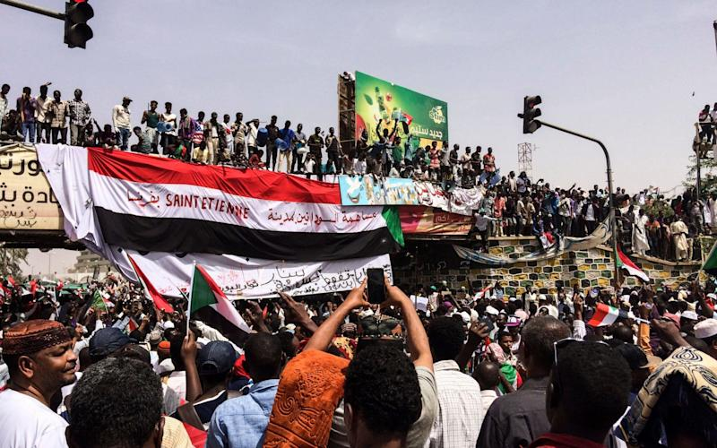 Demonstrators gather in Sudan's capital of Khartoum, Friday, April 12, 2019 - AP