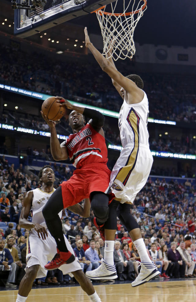 Portland Trail Blazers guard Wesley Matthews (2) drives to the basket against New Orleans Pelicans center Alexis Ajinca in the first half of an NBA basketball game in New Orleans, Monday, Dec. 30, 2013. (AP Photo/Gerald Herbert)