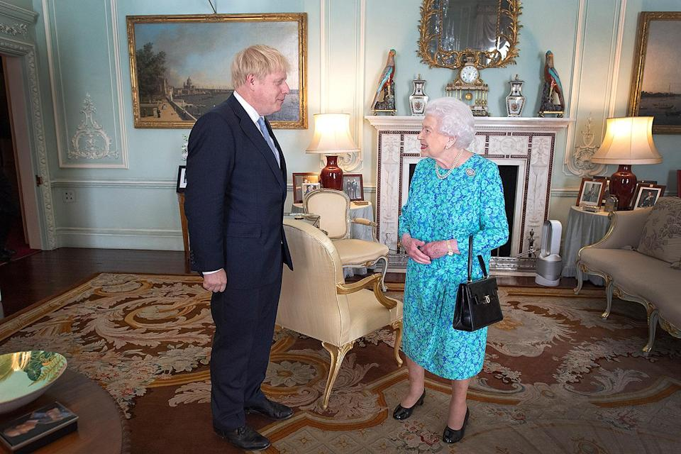 """<p>Queen Elizabeth keeps cool in Buckingham Palace with a little help from a high-tech fan, which also heats and cleans air!</p> <p><strong>Buy It! Dyson's Pure Hot + Cool Link Air Purifier, <a href=""""https://www.amazon.com/Dyson-Pure-Cool-Purifier-Heater/dp/B07KXPXN5T/ref=as_li_ss_tl"""" rel=""""sponsored noopener"""" target=""""_blank"""" data-ylk=""""slk:$550"""" class=""""link rapid-noclick-resp"""">$550</a></strong></p>"""