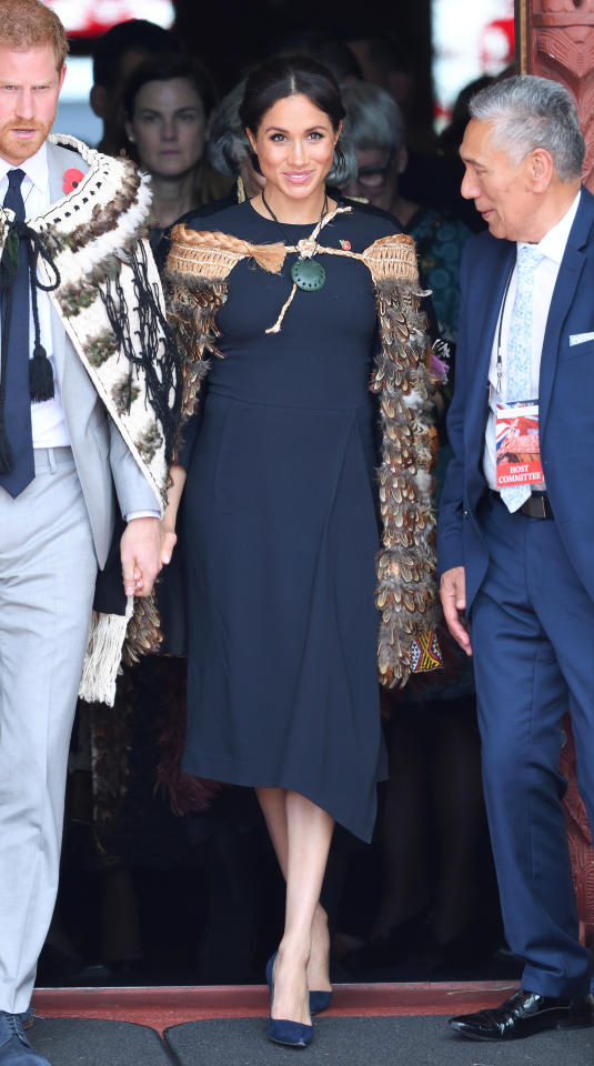 "<p>Markle arrived in Rotorua for a traditional ceremony Maori ceremony. The Duchess wore a navy blue Stella McCartney dress (approx $3,619.52 CAD) and her navy blue suede Manolo Blahnik pumps. Markle was gifted a <a rel=""nofollow"" href=""https://www.kirinathan.com/collections/pounamu/products/pounamu-kouma"">Pounamu Kouma</a> (approx. $605 CAD), an authentic jade necklace for the occasion. </p>"