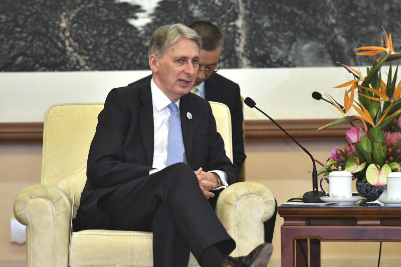 Britain's Chancellor of the Exchequer Philip Hammond speaks with Chinese Premier Li Keqiang, not pictured, during their meeting at the Diaoyutai State Guesthouse, Friday, April 26, 2019, in Beijing. (Parker Song/Pool Photo via AP)