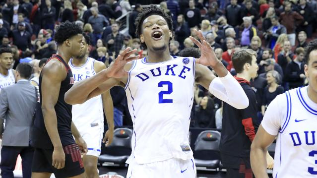 Duke's Cam Reddish celebrates the Blue Devils' win over Louisville on Tuesday. (AP)