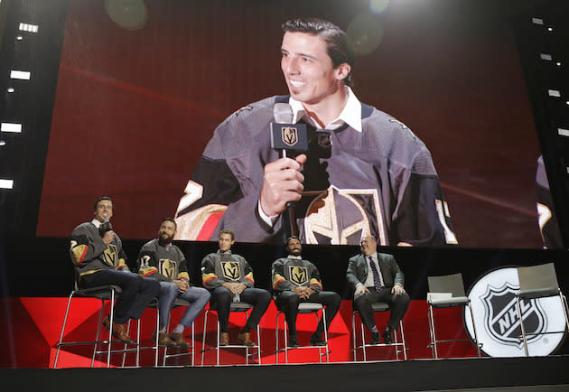 "From left, Vegas Golden Knights' <a class=""link rapid-noclick-resp"" href=""/nhl/players/3341/"" data-ylk=""slk:Marc-Andre Fleury"">Marc-Andre Fleury</a>, Deryk Engelland, Brayden McNabb and Jason Garrison sit on stage during an event following the NHL expansion draft, Wednesday, June 21, 2017, in Las Vegas. Fleury was picked by the Golden Knights in the NHL expansion draft. (AP Photo/John Locher)"