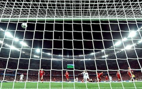 Real Madrid forward Gareth Bale scored a jaw-dropping overhead kick and a long distance strike to give them a 3-1 win over Liverpool in the Champions League final on Saturday, delivering a remarkable third consecutive title for the Spaniards. Substitute Bale, who also scored in Real's 2014 final win over Atletico Madrid, had only been on the pitch for three minutes when he rose to meet Marcelo's cross in the air from outside the box, sending it flying into the net to restore Real's lead in the 64th minute at the NSC Olympic Stadium. French forward Karim Benzema had put Madrid ahead in the 51st minute by sticking out a leg as Liverpool's German keeper Karius attempted to throw the ball to a team mate, sending it trickling over the line, but Sadio Mane levelled from close range in the 55th for Juergen Klopp's side. But how did each team's players do? Dan Zeqiri rates those who featured. Real Madrid Keylor Navas 6 Like opposite number Karius, Navas was viewed as a potential weak link. Flapped at one corner but did play sweeper-keeper behind Real's high line effectively. Dani Carvajal 6 Limped off moments after Salah to end an injury-ravaged season. One clumped back-pass straight for a corner was a notable lowlight of a truncated appearance. Ramos defended with authority Credit: Getty Images Sergio Ramos 7 Knew exactly what he was doing when wrestling Salah to the ground, but defended with authority and is such a source of strength to his teammates. Raphael Varane 8 Constantly left exposed by Real's open approach, but Varane's pace ensures he can cope in isolation. Made three vital interceptions during a strong Liverpool start. Marcelo 6 Could play as an attacking midfielder in most European teams, but this relatively subdued performance stood testament to Liverpool's tigerish work and closing of space. Casemiro 7 The modern embodiment of the 'water-carrier'. Casemiro made some important blocks as Liverpool pushed Real back in the opening exchanges but also passed assur