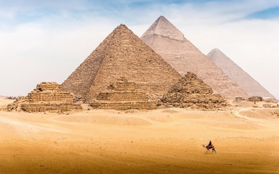 View of Pyramid complex of Giza, in Cairo Egypt - Kitti Boonnitrod/Moment RF