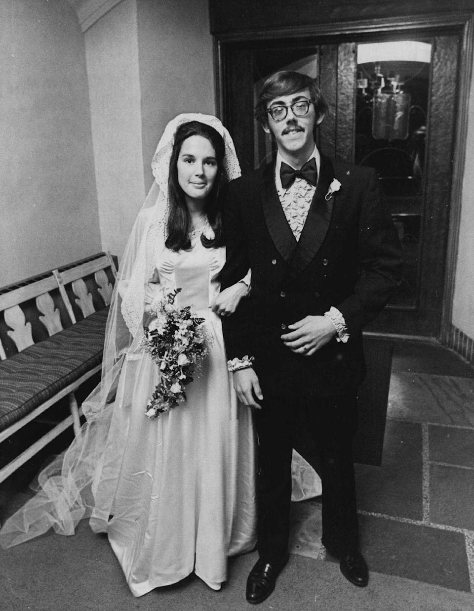 <p>It wouldn't be a '70s wedding without a guy wearing a ruffled shirt under his tux. The bride's look is more timeless, thanks to a floor-length gown and spray-style bouquet. </p>
