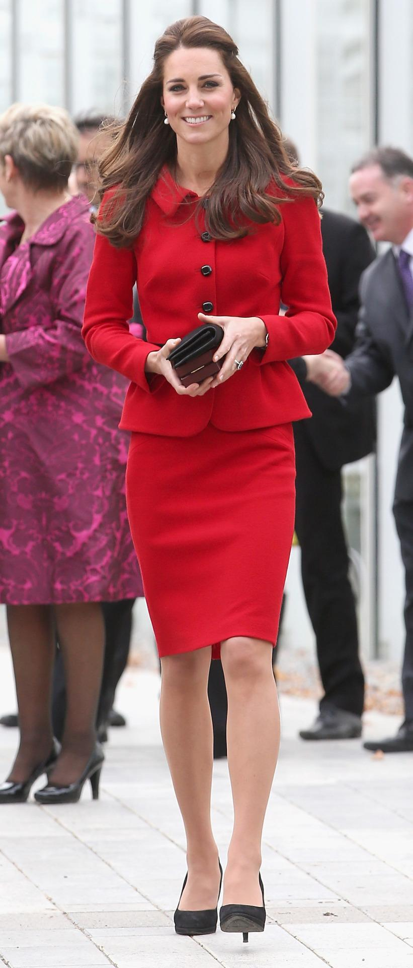 <p>Kate spent a day in Christchurch, New Zealand in a fitted red suit from Luisa Spagnoli. She carried a black Mulberry clutch and finished with suede pumps by Episode. </p><p><i>[Photo: PA]</i></p>