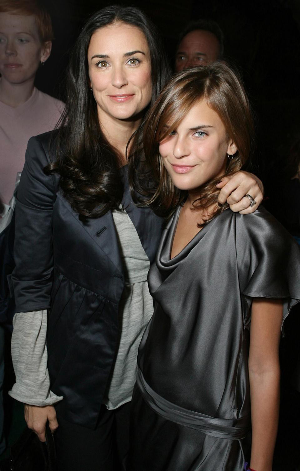 <p>Moore and Tallulah gave the same smile for the camera while at the premiere of <em>Open Season </em>in Los Angeles, showing off their very similar apple-round cheekbones. </p>