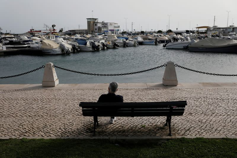A man is seated in a bench at Faro marine, during the coronavirus disease (COVID-19) pandemic in Faro