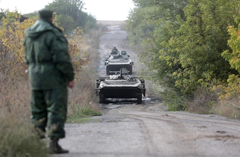 1 killed as large fire rips through Ukraine military arsenal