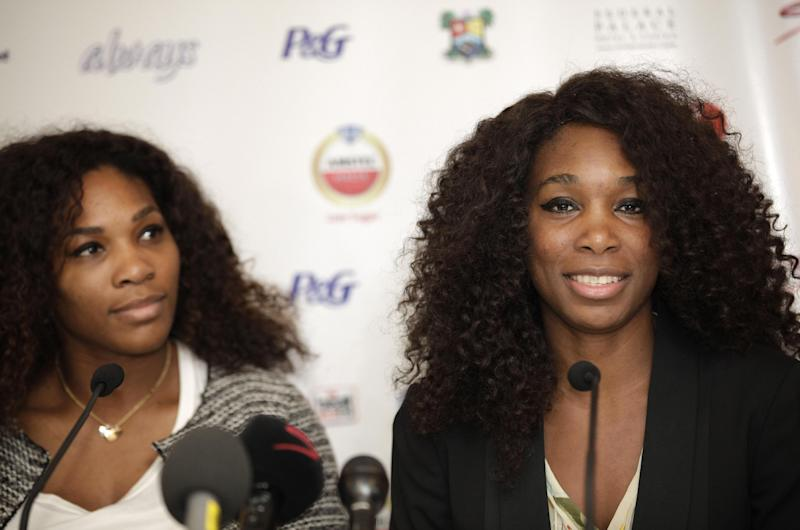 U.S Tennis star Serena Williams, left, and Venus Williams attend a press conference in Lagos, Nigeria. Wednesday, Oct. 31, 2012. Tennis stars Serena and Venus Williams say they eagerly await playing in the 2016 Olympics after their third doubles gold this year. The two sisters made the comments Wednesday in Lagos, Nigeria's largest city, during their first visit to the country. (AP Photo/Sunday Alamba)