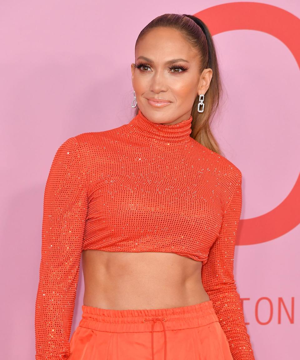 """<h3>2019</h3><br>This, ladies and gents, is the winning J.Lo beauty combination we'll happily attempt to master for the rest of our lives: beaming skin, full lashes, coral cheeks and lips, and a sleek ponytail.<span class=""""copyright"""">Photo: ANGELA WEISS/AFP/Getty Images.</span>"""