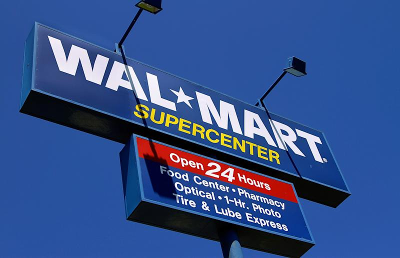 The WalMart Supercenter signage is seen in Springfield, Ill., Monday, May 16, 2011. Wal-Mart Stores Inc. is reporting Tuesday, May 17, a 3 percent increase in first-quarter net income, beating Wall Street expectations because of robust international business and cost controls.  (AP Photo/Seth Perlman)