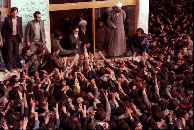 FILE - In this Feb. 2, 1979 file photo, Ayatollah Ruhollah Khomeini, center, is greeted by supporters in Tehran, Iran. Friday, Feb. 1, 2019 marks the 40th anniversary of Iran's exiled Ayatollah Ruhollah Khomeini return to Tehran, a moment that changed the country's history for decades to come. That revolution would spark the U.S. Embassy takeover and hostage crisis, stoking the animosity that exists between Tehran and Washington to this day. (AP Photo, File)