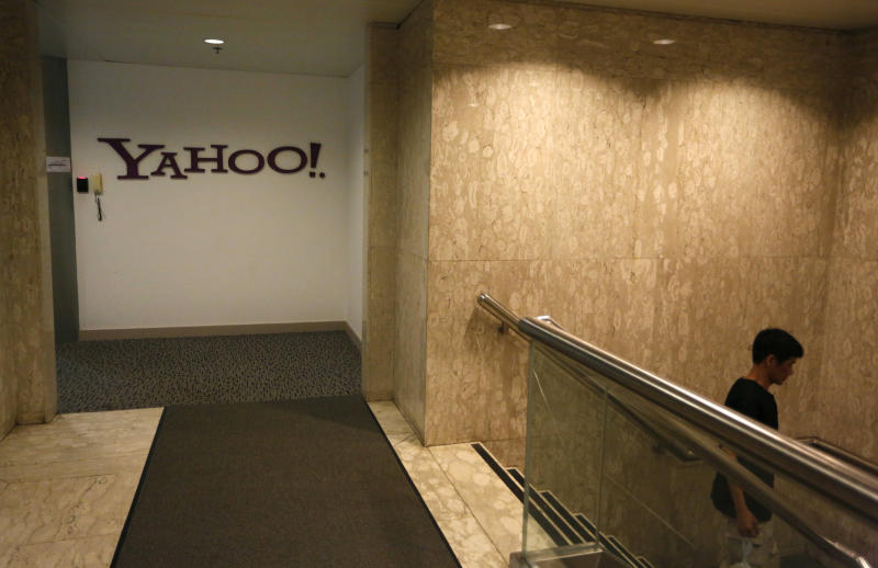 The logo of Yahoo is seen in Hong Kong office in Hong Kong Monday, May 21, 2012. Struggling Internet company Yahoo Inc. has secured a lifeline after agreeing to sell half of its prized stake in Chinese e-commerce group Alibaba for about $7.1 billion, with most of the cash going to shareholders. (AP Photo/Vincent Yu)