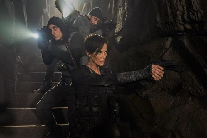 """Matthias Schoenaerts (""""Booker""""), left, Charlize Theron (""""Andy"""") and Luca Marinelli (""""Nicky"""") in a scene from """"The Old Guard."""" <span class=""""copyright"""">(Aimee Spinks / Netflix)</span>"""