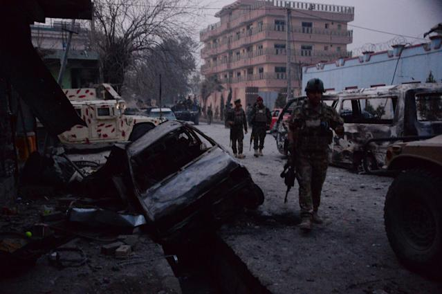 <p>Afghan security forces inspect the site of attack on British charity Save the Children office in Jalalabad on Jan. 24, 2018. (Photo: Noorullah Shirzada/AFP/Getty Images) </p>
