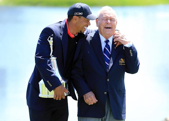 <p>Tiger Woods of the United States is presented with the trophy by Arnold Palmer of the United States, the win meant he re-gained the World's number one position after the final round of the 2013 Arnold Palmer Invitational Presented by Mastercard at Bay Hill Golf and Country Club on March 25, 2013 in Orlando, Florida. (Photo by David Cannon/Getty Images) </p>