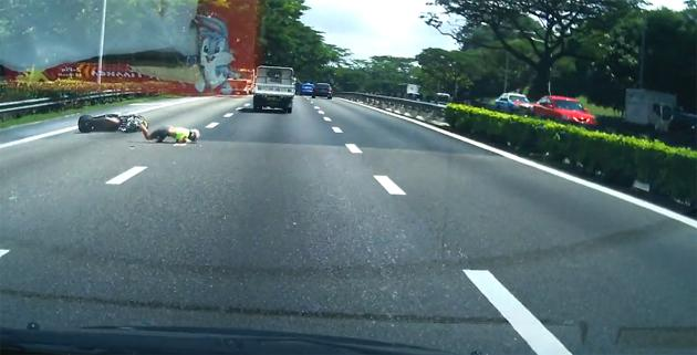A reckless lorry driver crashes into a motorcyclist on PIE. (Screengrab)