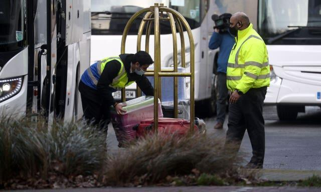 Bags are unloaded at a Holiday Inn near Heathrow Airport