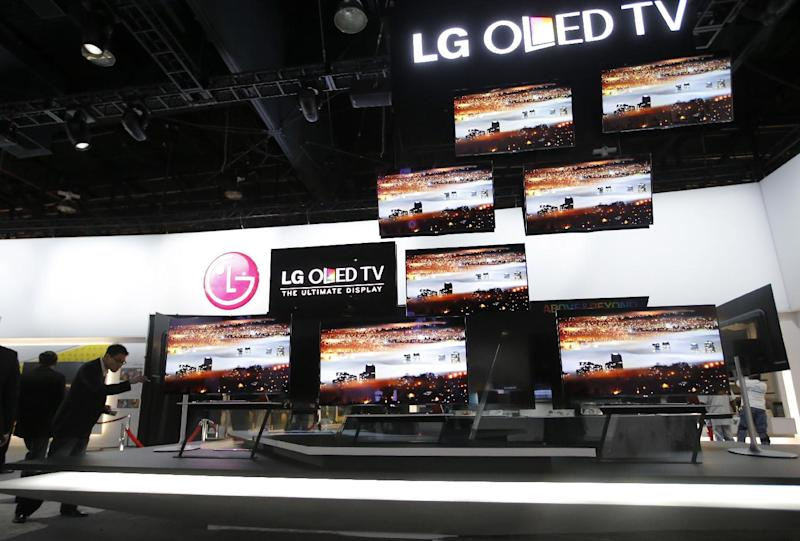 LG OLED televisions are displayed at the LG booth at the International Consumer Electronics Show in Las Vegas, Monday, Jan. 7, 2013. The 2013 International CES gadget show, the biggest trade show in the Americas, is taking place in Las Vegas this week.  (AP Photo/Jae C. Hong)