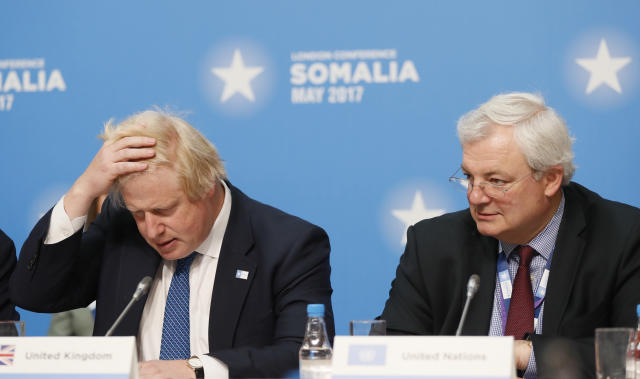 Britain's Foreign Secretary Boris Johnson, left, listens during a National Security session at the 2017 Somalia Conference in London, Thursday, May 11, 2017. The Somalia Conference is aimed at improving stability and prosperity in Somalia and boosting the humanitarian response to the drought. (AP Photo/Kirsty Wigglesworth)