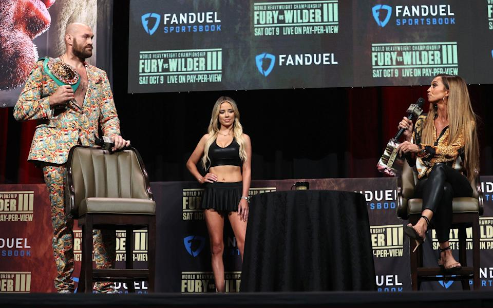 WBC heavyweight champion Tyson Fury (L) speaks to Kate Abdo (R) during the press conference at MGM Grand Garden Arena - Getty Images