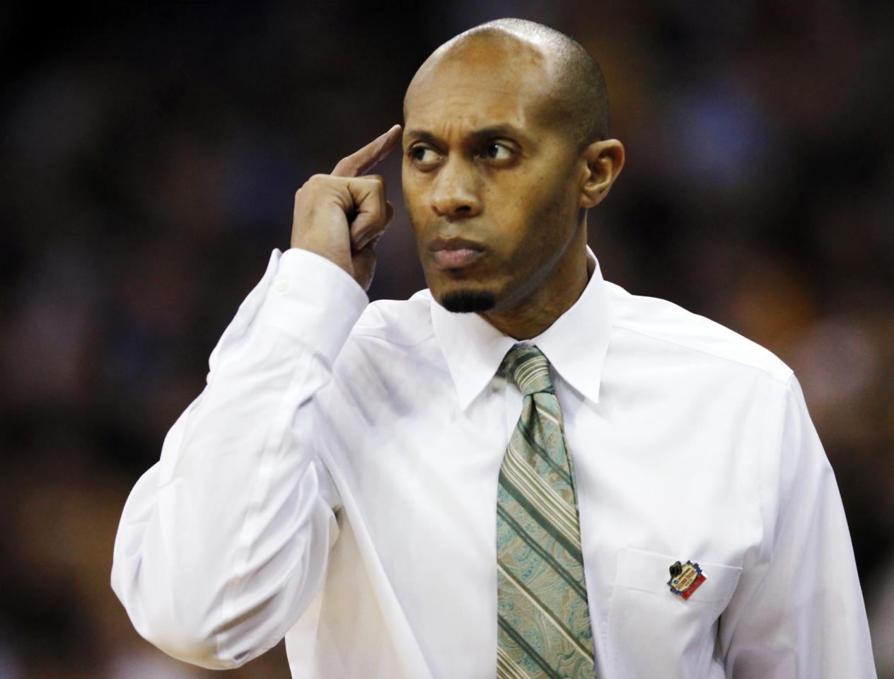 Norfolk State coach Anthony Evans signals his team during the first half of an NCAA college basketball tournament game against Missouri at CenturyLink Center in Omaha, Neb., Friday, March 16, 2012. (AP Photo/Nati Harnik)