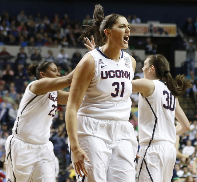Connecticut center Stefanie Dolson (31) celebrates a basket against Notre Dame during the first half of the championship game in the Final Four of the NCAA women's college basketball tournament, Tuesday, April 8, 2014, in Nashville, Tenn. (AP Photo/John Bazemore)