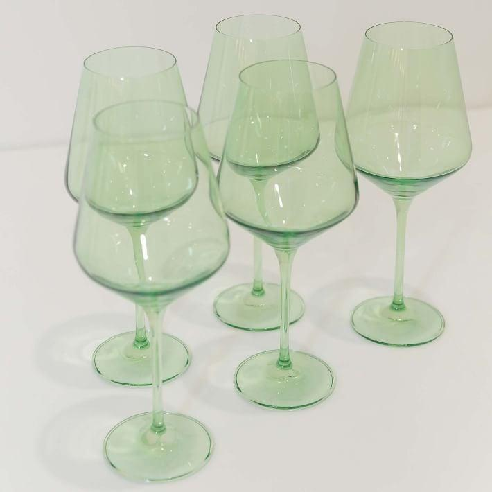 <p>These <span>Estelle Colored Glass Stemmed Wine Glasses</span> ($175) will look so chic on their kitchen shelves.</p>