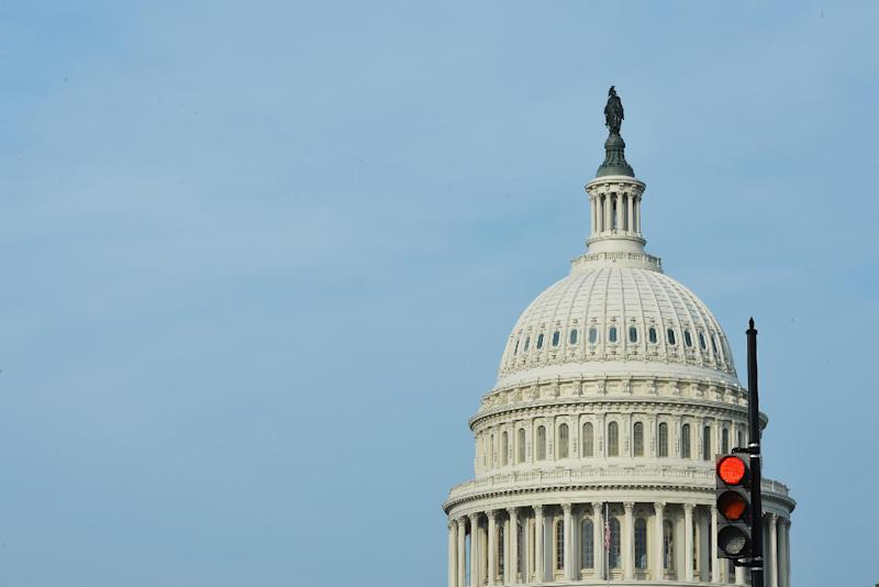 A traffic light shows red in front of the US Capitol on October 3, 2013 in Washington