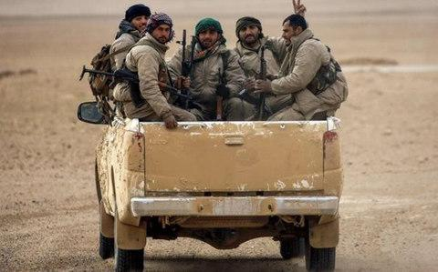 Kurdish and Arab fighters will make up the 30,000-strong border force - Credit: AFP