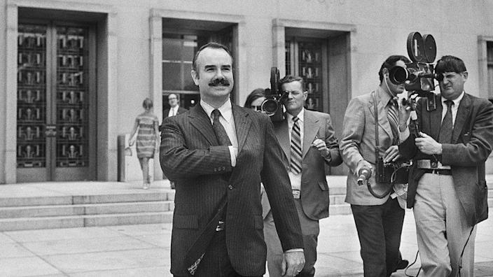 Former White House aide G. Gordon Liddy was filmed by a journalist leaving the US District Court. There he pleaded not guilty to invading the Democratic National Convention at the Watergate Hotel.