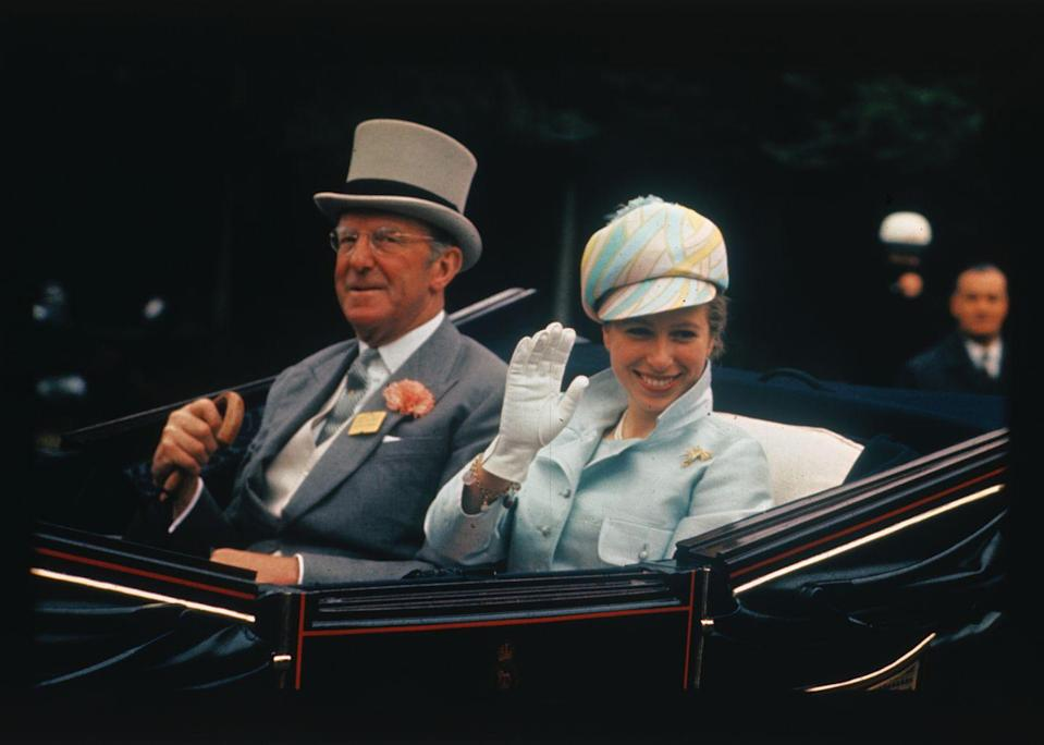 <p>Arriving at the Royal Ascot Race with her escort, the Duke of Beaufort.</p>