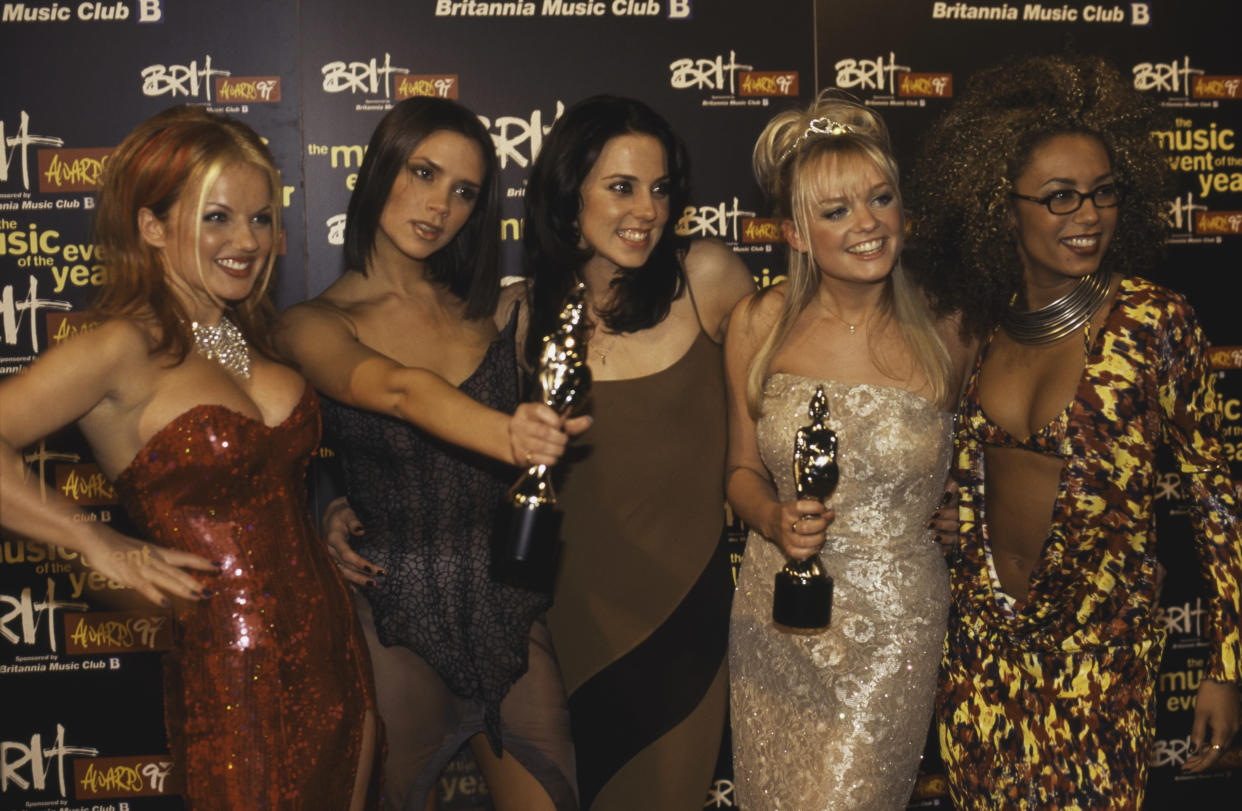 English pop girl group The Spice Girls with their awards at the 1997 Brit Awards, held at Earls Court Exhibition Centre, London, 24th February 1997. The group won awards for Best British Single (for 'Wannabe') and Best British Video (for 'Say You'll Be There'). Left to right: Geri Halliwell ('Ginger Spice'), Victoria Beckham ('Posh Spice'), Melanie Chisholm ('Sporty Spice'), Emma Bunton ('Baby Spice') and Melanie Brown ('Scary Spice'). (Photo by Patrick Ford/Redferns/Getty Images)