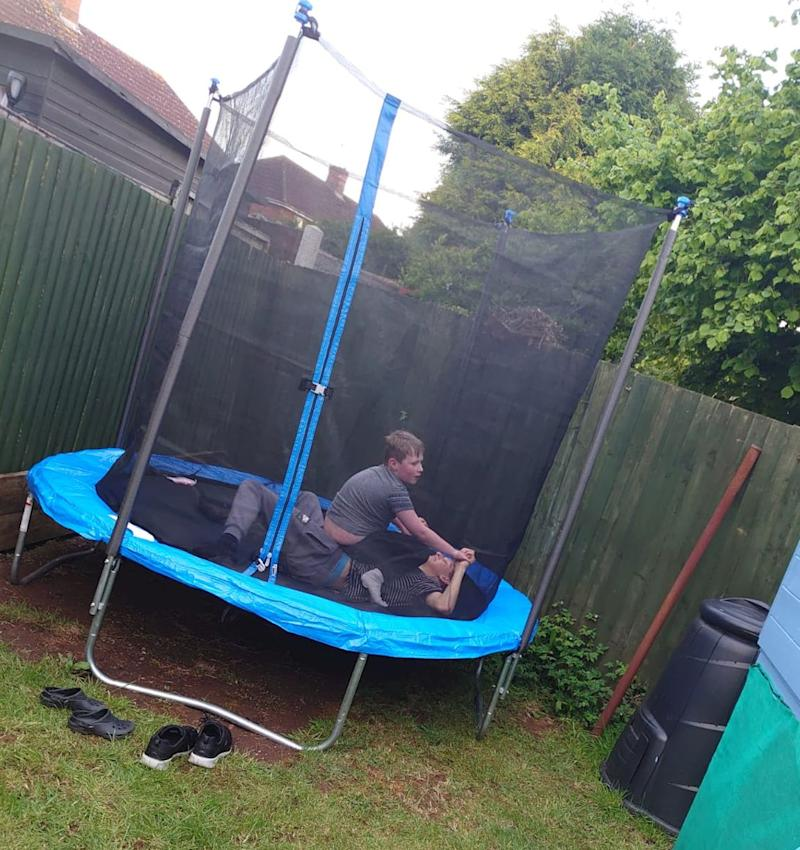 Stanley and Nathan playing on the trampoline provided by Action for Children (Photo: Jenny Hobbs)