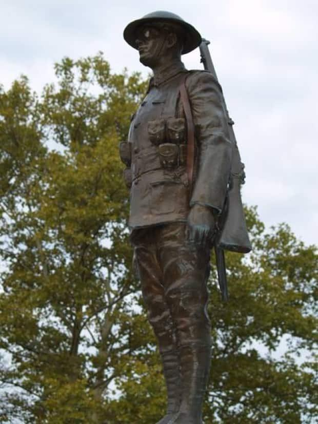 A statue of a soldier at the Victoria Park war memorial in Sarnia is shown with a rifle that has since been stolen. (Sarnia Police Service - image credit)