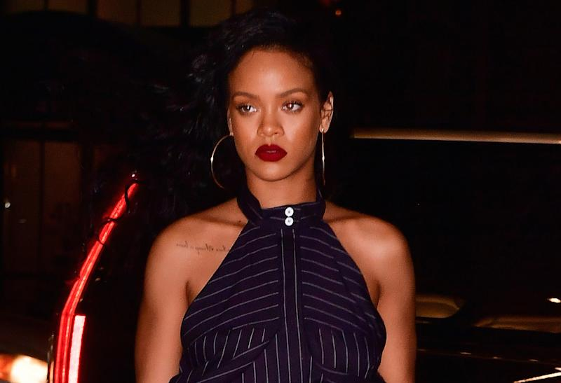 Rihanna mixes pinstripes with leopard print, proving once again she's our style hero