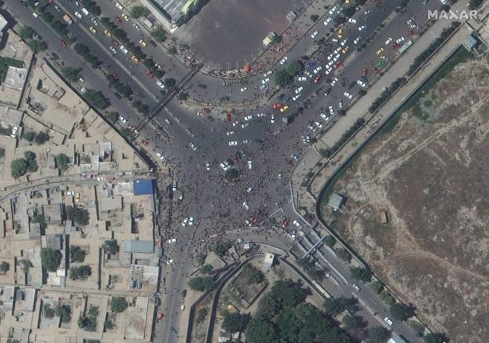 A satellite image released by Maxar Technologies shows crowds near the entrance to Kabul's international airport on Aug. 16, 2021.