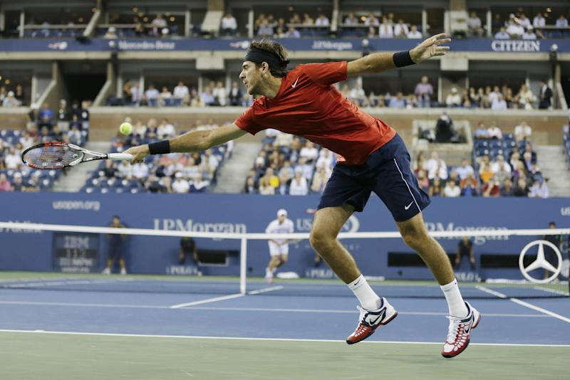 Argentina's Juan Martin Del Potro returns a shot to Andy Roddick in the fourth round of play at the 2012 US Open tennis tournament, Tuesday, Sept. 4, 2012, in New York. (AP Photo/Darron Cummings)