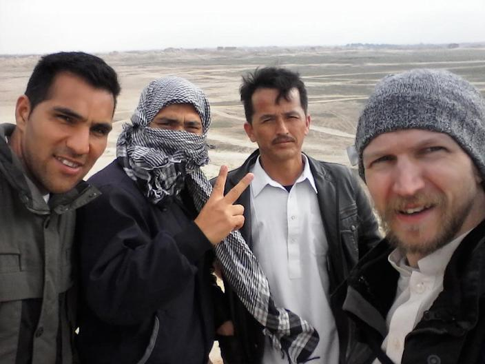 Irish tourist Jonny Blair (R) poses for a photo with three locals during his travels in Afghanistan (AFP Photo/Jonny Blair)