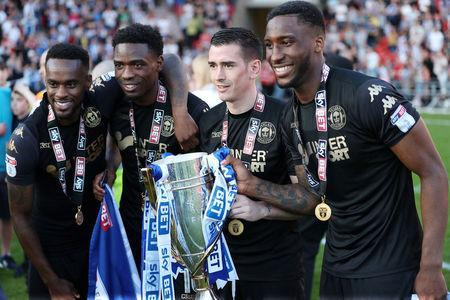 Soccer Football - League One - Doncaster Rovers vs Wigan Athletic - Keepmoat Stadium, Doncaster, Britain - May 5, 2018 Wigan Athletic players celebrate with the trophy after winning League One Action Images/John Clifton