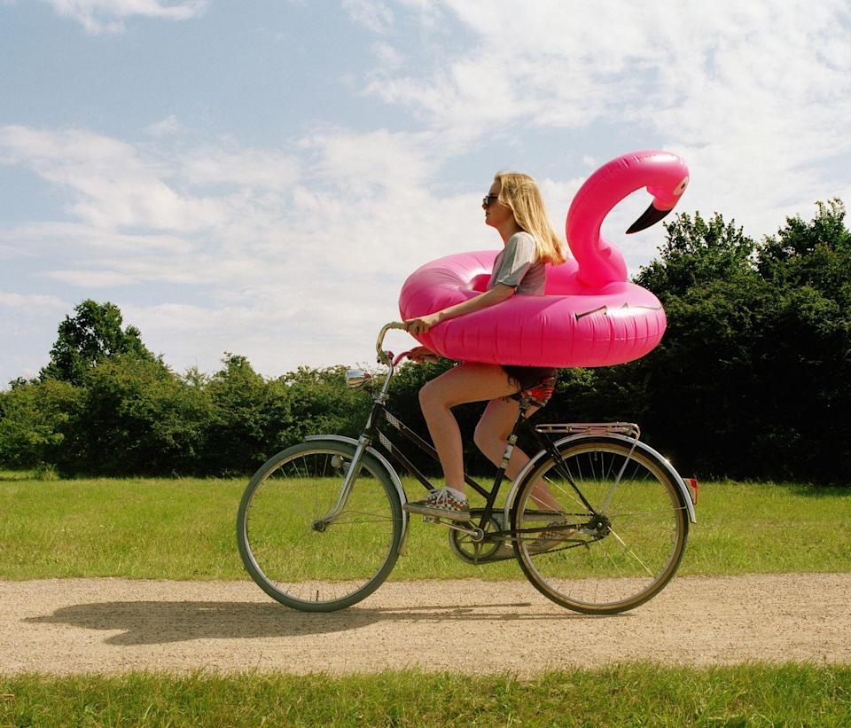"""<p>Channel your inner child and swap out the sedan for a cruiser of a different kind. The best way to enjoy a summer breeze is when you're footloose and fancy free, pedaling down a bike path. Our one suggestion: Swap out the <a href=""""https://www.amazon.com/Intex-Flamingo-Inflatable-Ride-Ages/dp/B01KGS6022/ref=sr_1_7"""" rel=""""nofollow noopener"""" target=""""_blank"""" data-ylk=""""slk:flamingo float"""" class=""""link rapid-noclick-resp"""">flamingo float</a> for a <a href=""""https://www.amazon.com/Schwinn-Helmet-Intercept-Collection-Adult/dp/B077FVQ5SF/ref=redir_mobile_desktop"""" rel=""""nofollow noopener"""" target=""""_blank"""" data-ylk=""""slk:bike helmet"""" class=""""link rapid-noclick-resp"""">bike helmet</a>.</p>"""