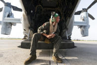 """U.S. Marine Corps Lance Cpl. Brandon Oldham, waits to take off after aid was loaded onto a VM-22 Osprey at Toussaint Louverture International Airport, Saturday, Aug. 28, 2021, in Port-au-Prince, Haiti. The VMM-266, """"Fighting Griffins,"""" from Marine Corps Air Station New River, from Jacksonville, N.C., are flying in support of Joint Task Force Haiti after a 7.2 magnitude earthquake on Aug. 22, caused heavy damage to the country. (AP Photo/Alex Brandon)"""