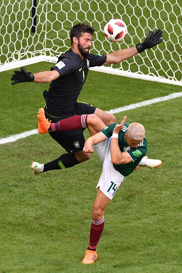 <p>Mexico's forward Javier Hernandez (R) vies for the ball with Brazil's goalkeeper Alisson during the Russia 2018 World Cup round of 16 football match between Brazil and Mexico at the Samara Arena in Samara on July 2, 2018. (Photo by SAEED KHAN / AFP) </p>